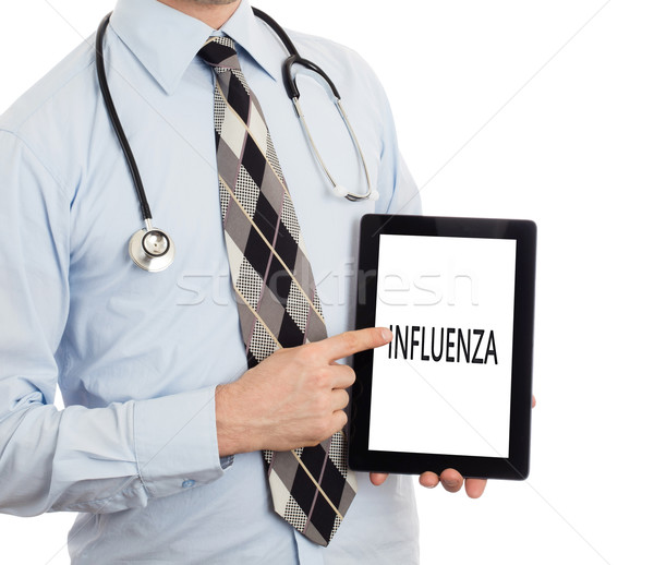 Orvos tart tabletta influenza izolált fehér Stock fotó © michaklootwijk