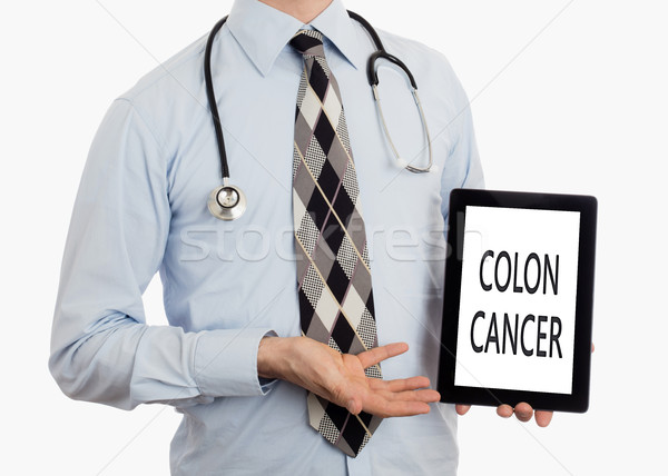 Doctor holding tablet - Colon cancer Stock photo © michaklootwijk