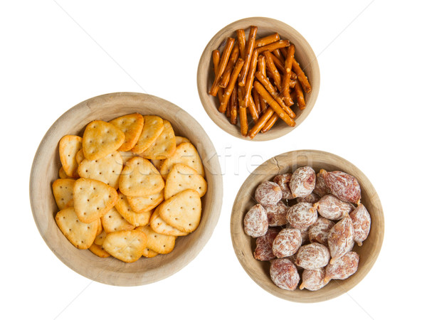 Stock photo: Italian salami and typical dutch salty snacks in wooden bowl