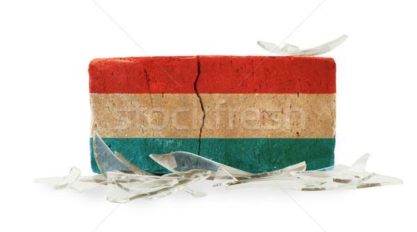 Baksteen gebroken glas geweld vlag Luxemburg muur Stockfoto © michaklootwijk