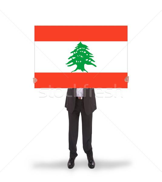 üzletember tart nagy kártya zászló Libanon Stock fotó © michaklootwijk