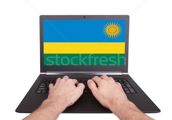 Ręce pracy laptop Rwanda ekranu Zdjęcia stock © michaklootwijk