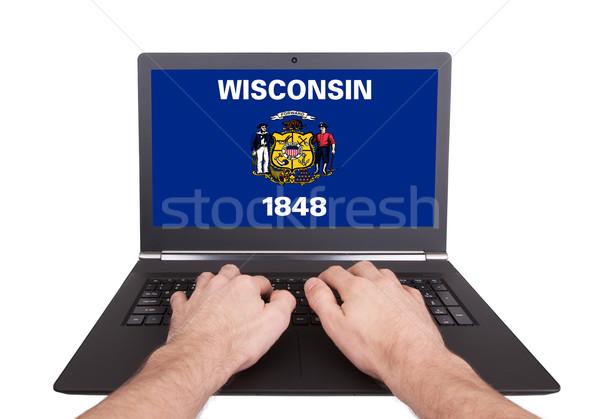 Mains travail portable Wisconsin écran Photo stock © michaklootwijk