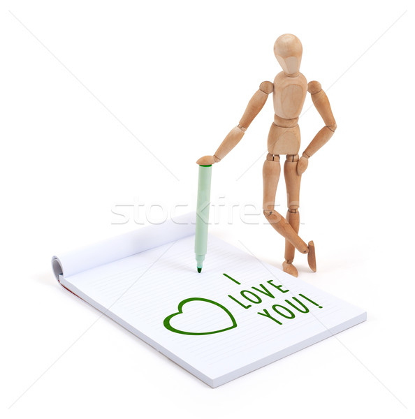 Wooden mannequin writing in scrapbook - I love you Stock photo © michaklootwijk
