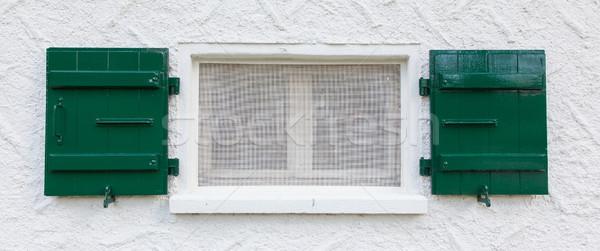 Open wooden  green shutters Stock photo © michaklootwijk