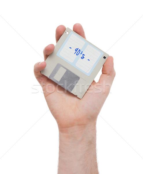 Disco armazenamento de dados apoiar isolado branco mão Foto stock © michaklootwijk