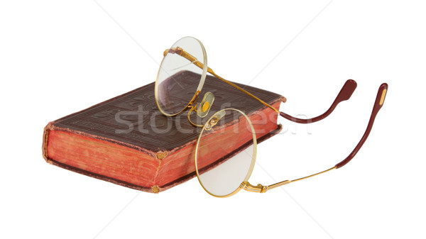 Very old glasses and a red book isolated Stock photo © michaklootwijk