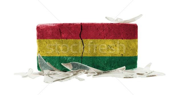 Baksteen gebroken glas geweld vlag Bolivia muur Stockfoto © michaklootwijk