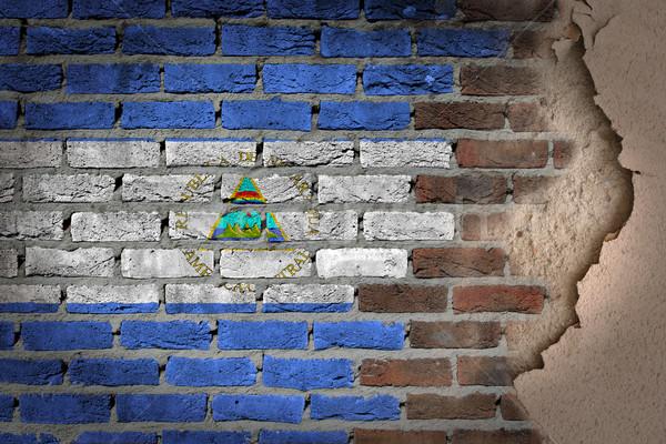 Sötét téglafal tapasz Nicaragua textúra zászló Stock fotó © michaklootwijk