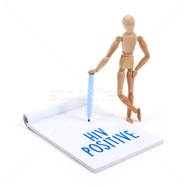 Wooden mannequin writing - HIV positive Stock photo © michaklootwijk