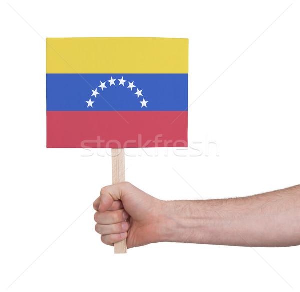 Kéz tart kicsi kártya zászló Venezuela Stock fotó © michaklootwijk