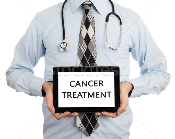 Doctor holding tablet - Cancer treatment Stock photo © michaklootwijk