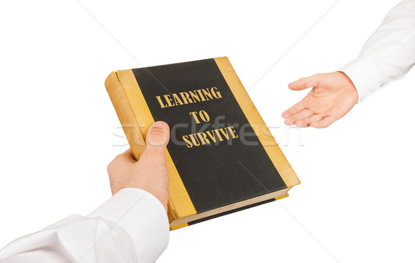 Businessman giving an used book to another businessman Stock photo © michaklootwijk