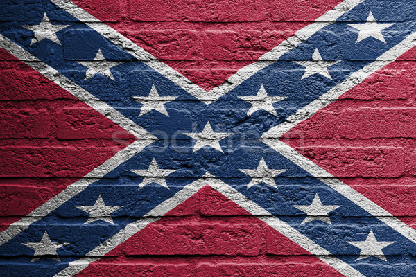 Brick wall with a painting of a flag, confederate flag Stock photo © michaklootwijk