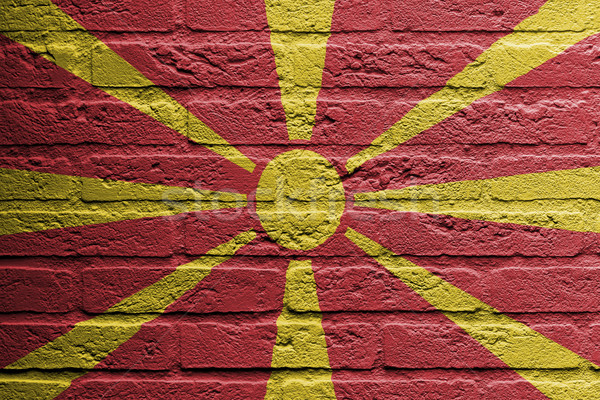 Pared de ladrillo pintura bandera Macedonia aislado pintura Foto stock © michaklootwijk
