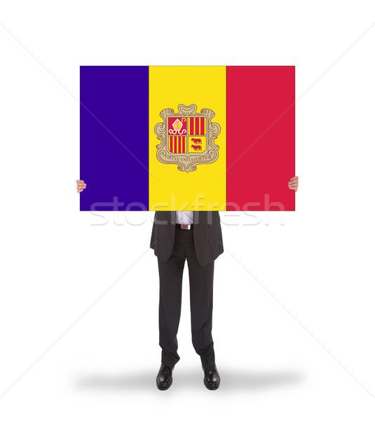Stock photo: Businessman holding a big card