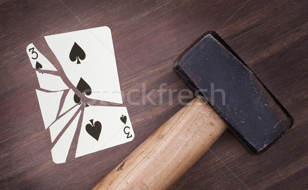 Hammer with a broken card, three of spades Stock photo © michaklootwijk