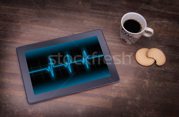 Electrocardiogram on a tablet - Concept of healthcare Stock photo © michaklootwijk