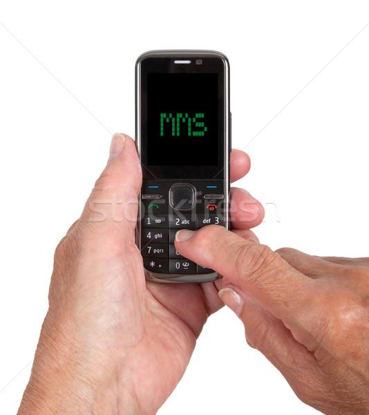 Handen senior vrouw mobiele telefoon mms telefoon Stockfoto © michaklootwijk