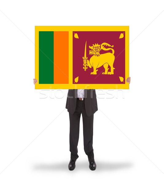 Businessman holding a big card, flag of Sri Lanka Stock photo © michaklootwijk