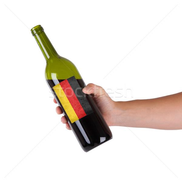 Mano botella vino tinto etiqueta Alemania Foto stock © michaklootwijk