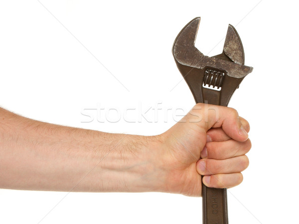Old rusted adjustable vector wrench in a hand Stock photo © michaklootwijk