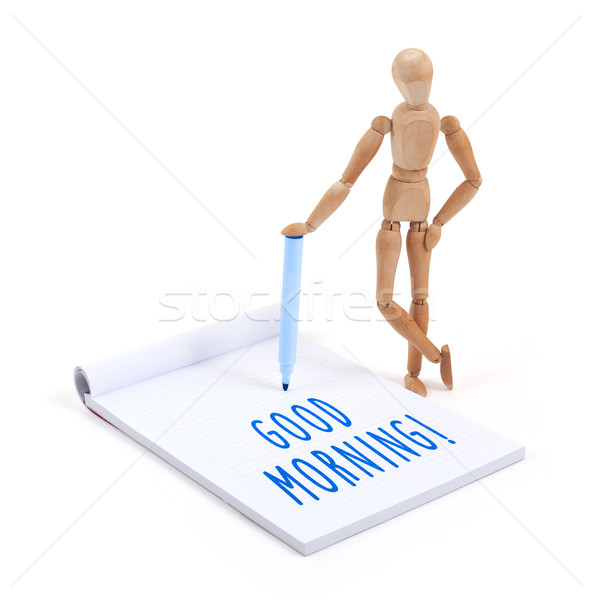 Wooden mannequin writing in scrapbook - Good morning Stock photo © michaklootwijk
