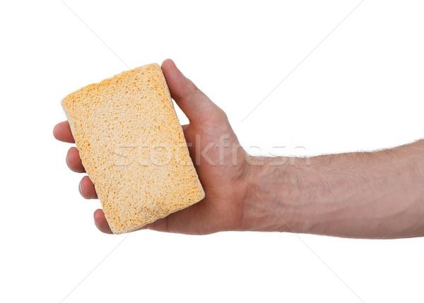 Amarelo esponja branco mão adulto homem Foto stock © michaklootwijk