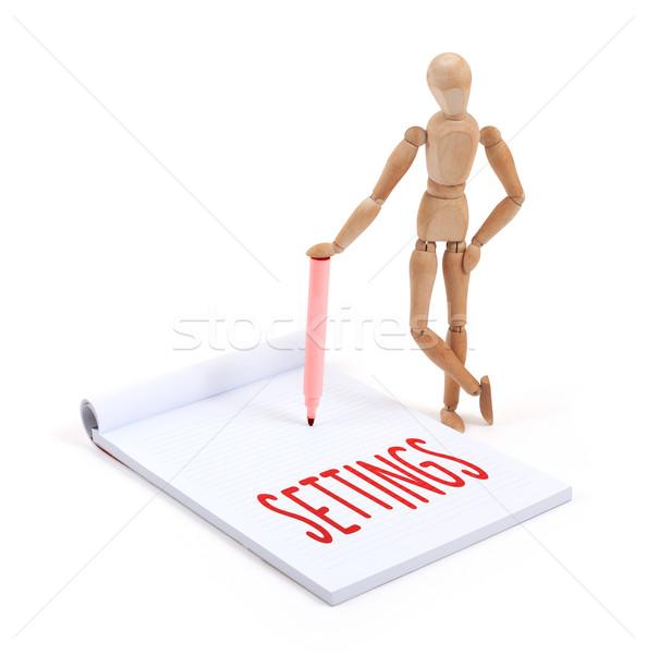 Wooden mannequin writing - Settings Stock photo © michaklootwijk