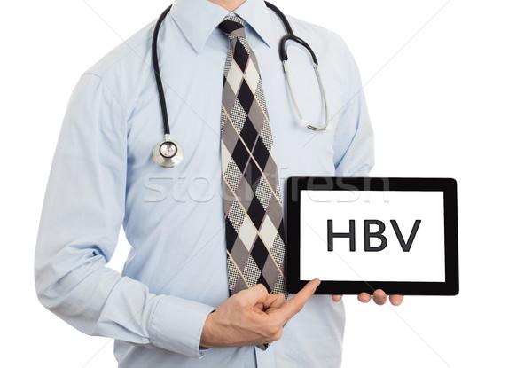 Doctor holding tablet - HBV Stock photo © michaklootwijk