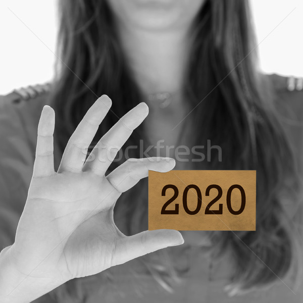 Woman showing a business card - 2020 Stock photo © michaklootwijk