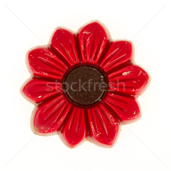 Damaged red chocolate flower, isolated Stock photo © michaklootwijk