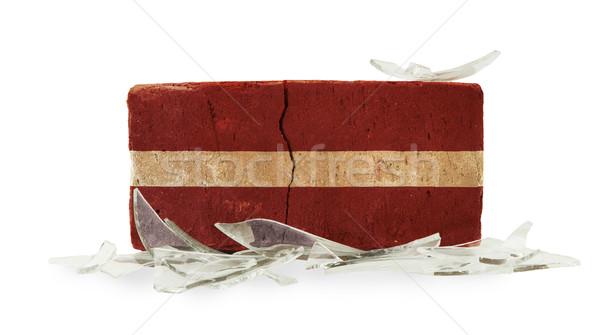 Tuğla kırık cam şiddet bayrak Letonya duvar Stok fotoğraf © michaklootwijk