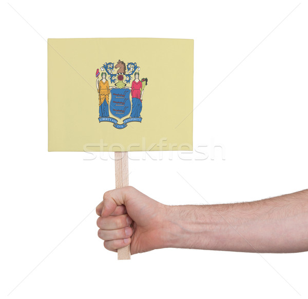 Hand holding small card - Flag of New Jersey Stock photo © michaklootwijk