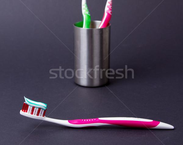 Rosa escova de dentes creme dental cinza sorrir casa Foto stock © michaklootwijk
