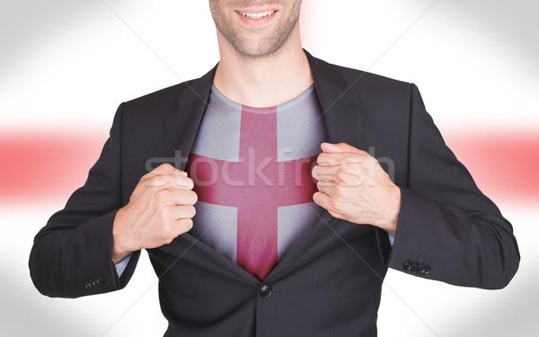 Imprenditore apertura suit shirt bandiera Inghilterra Foto d'archivio © michaklootwijk