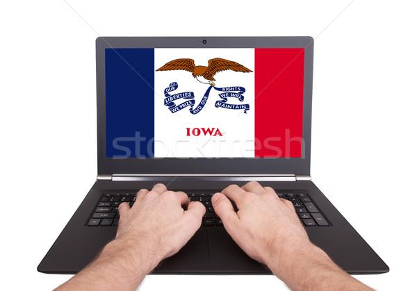рук рабочих ноутбука Айова экране Сток-фото © michaklootwijk