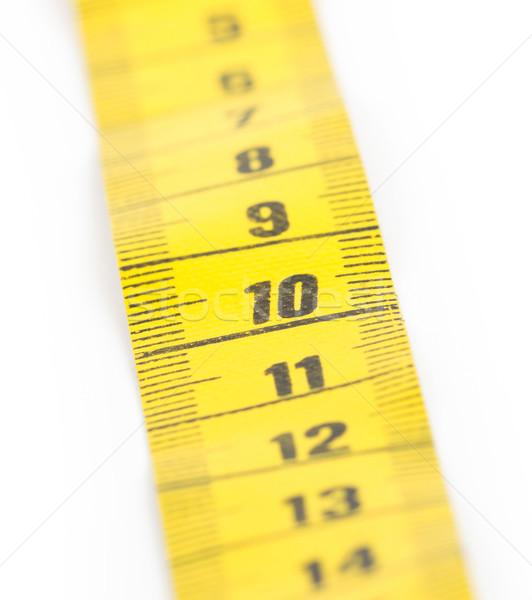 Yellow measuring tape isolated - selective focus Stock photo © michaklootwijk