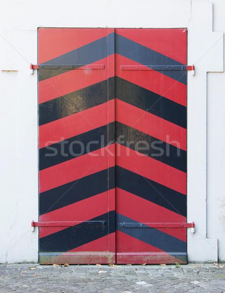 Old red door of a building Stock photo © michaklootwijk