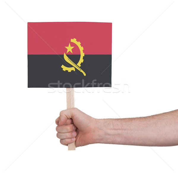 Hand holding small card - Flag of Angola Stock photo © michaklootwijk