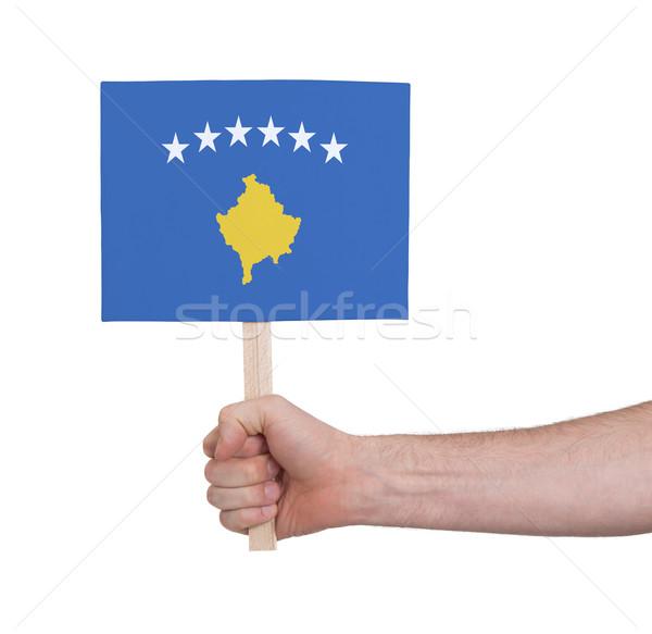 Hand holding small card - Flag of Kosovo Stock photo © michaklootwijk