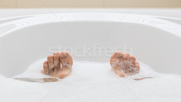 Men's feet in a bathtub, selective focus on toes Stock photo © michaklootwijk