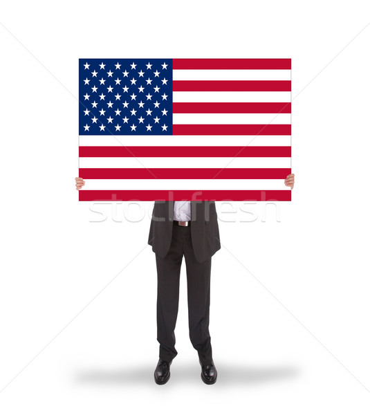 Smiling businessman holding a big card, flag of the United State Stock photo © michaklootwijk