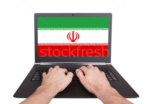 Stock photo: Hands working on laptop, Iran