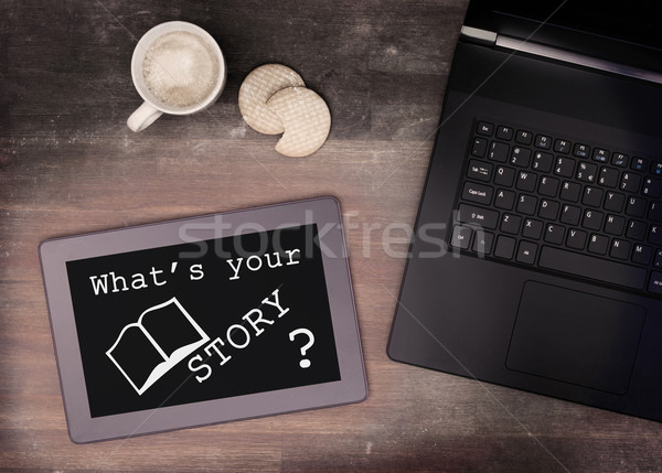Tablet touch computer gadget on wooden table, what's your story Stock photo © michaklootwijk