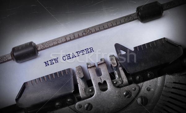 Vintage edad máquina de escribir nuevos capítulo Foto stock © michaklootwijk