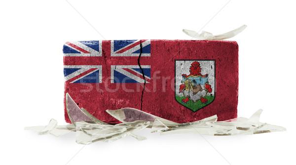 грубо сломанной кирпичных изолированный белый флаг Сток-фото © michaklootwijk