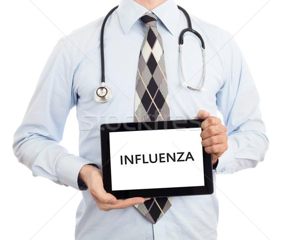 Doktor tablet grip yalıtılmış beyaz Stok fotoğraf © michaklootwijk