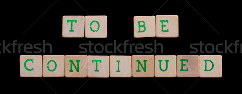 Green letters on old wooden blocks (to be continued) Stock photo © michaklootwijk