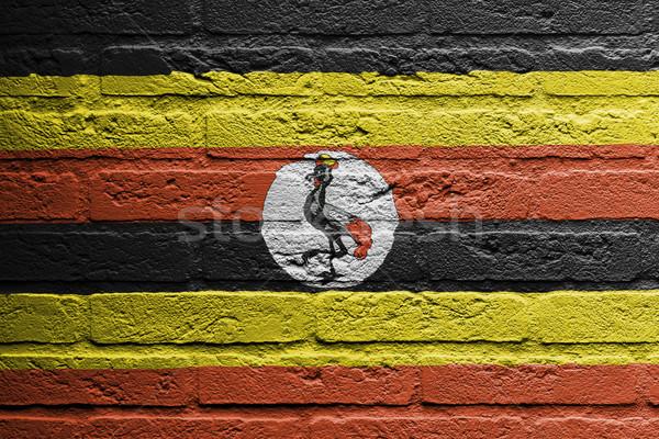 Tuğla duvar boyama bayrak Uganda yalıtılmış tuğla Stok fotoğraf © michaklootwijk
